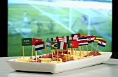 Ham and cheese on sticks with flags in front of television