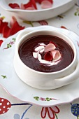 Cold cherry soup with rose petals