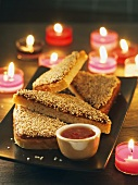 Toast triangles with shrimp paste and sesame (Thailand)