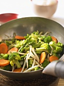 Broccoli, carrots, asparagus and sprouts cooked in wok