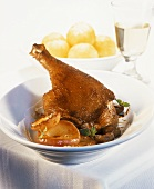Goose leg with apple slices, chestnuts & potato dumplings