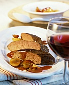Venison fillet with grapes cooked in red wine