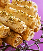 Filo pastry rolls filled with ricotta and pistachios
