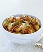 Potato salad with red onions and parsley