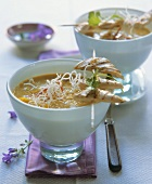 Curried mango soup with chicken skewer