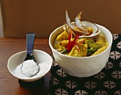 Mango curry with banana, pepper and coconut flakes