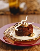 Chocolate soufflé with white chocolate sauce