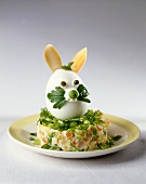 Boiled egg Easter Bunny on vegetable salad in mayonnaise