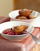Deep-fried dough balls with rhubarb compote