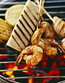 Grilled corn-fed chicken and scampi kebabs