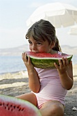Small girl eating watermelon