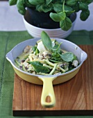 Mangetout and courgette stew in basil cream