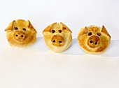 Three 'Lucky Pigs' in puff pastry