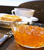 Orange marmalade in a small glass bowl