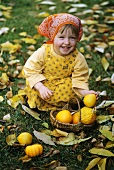 Small girl laughing with baby squashes