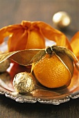Oranges on silver tray as table decoration