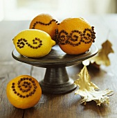 Oranges & lemon studded with cloves on a pedestal stand