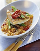 Fried zander on sauerkraut with peppers and pearl barley