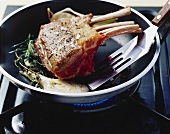 Browning rack of lamb in a frying pan