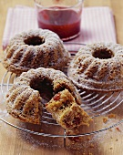 Three small spiced cranberry and nut cakes