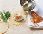 Making ravioli with trout and crayfish filling