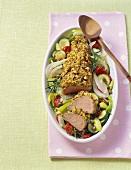Pork fillet with mustard crust on roasted vegetables