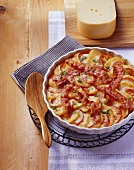 Potato and tomato bake with onions and bacon