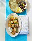 Redfish & vegetable skewers, roast potatoes & cucumber dip