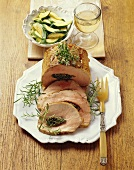 Italian-style stuffed roast pork with courgettes