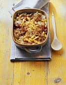 Spaetzle bake with onions, bacon and button mushrooms