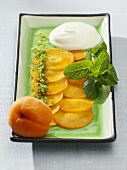 Apricot carpaccio with mint sugar and lemon cream