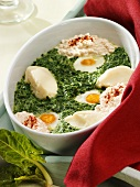 Baked eggs with spinach, soft cheese and mashed potato