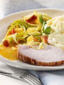 Slice of smoked pork with apples & leeks & mashed potato