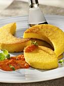 Polenta slices with tomato sauce