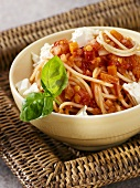 Spaghetti with tomato and lentil sauce and feta