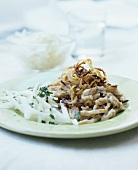Wholemeal cheese spaetzle with fried onions & radish salad