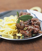 Noodles with spicy venison ragout (Ayurvedic cuisine)