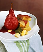 Pear with fruits of the forest sauce and slices of cake