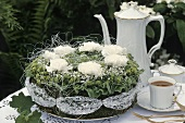 Green & white spring arrangement in shape of cake, coffee things