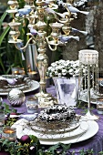 Festive table decoration in silver & violet with candelabrum