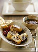 Sweet dumplings (potato dough) with poppy seeds & apricot sauce