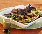 Braised veal ribs on pepper salad