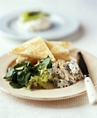Haddock with salad and toast triangles