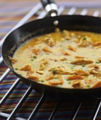Chicken and sweet potato curry in a frying pan