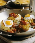 Small potato rosti with fried eggs and bacon
