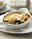 Savoury fish and spinach bake in a baking dish