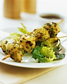 Spicy poultry kebabs with salad