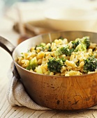 Macaroni cheese with broccoli served in a copper pan