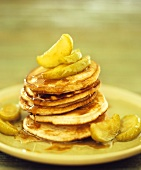 Pancakes with apple wedges and maple syrup