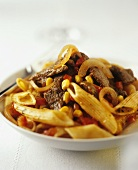 Penne with beef, onions, tomatoes and sweetcorn